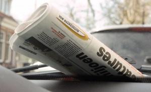 Afbeelding krant met Autocenter Bol Logo